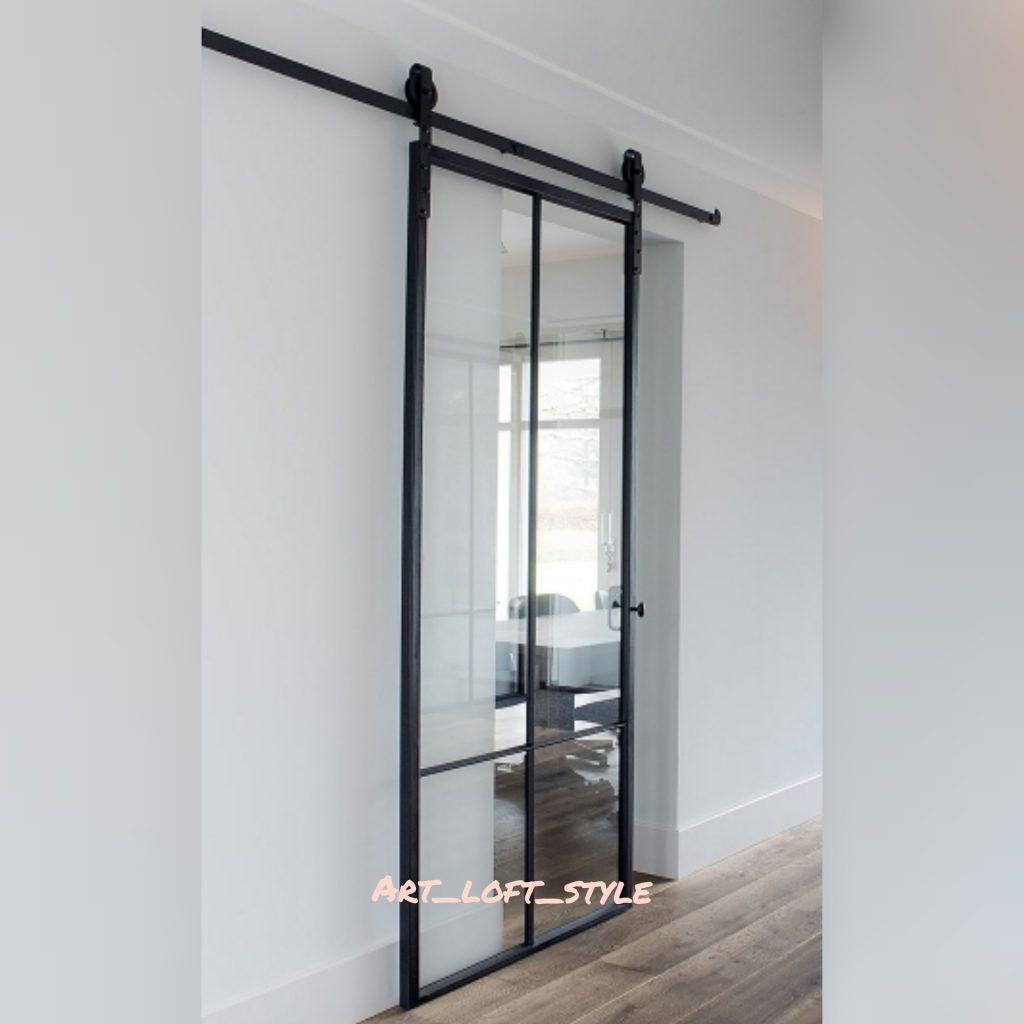 Стеклянная дверь из стекла и стали на откатном, амбарном механизме. Стильная дизайнерская дверь с прозрачным стеклом.